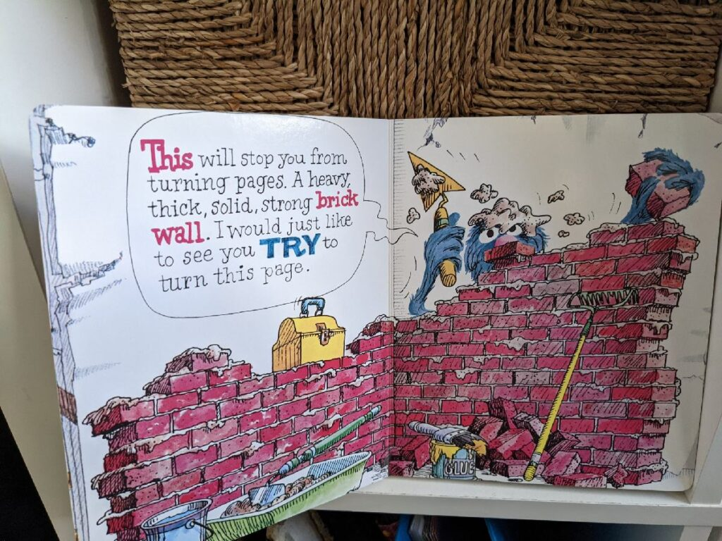 Grover building a brick wall so you cannot turn the page the the monster at the end of the book.